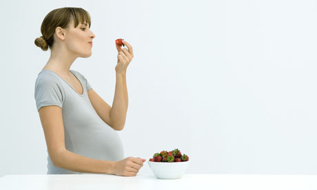 pregnant women eating. Pregnant-woman-eating-str-001